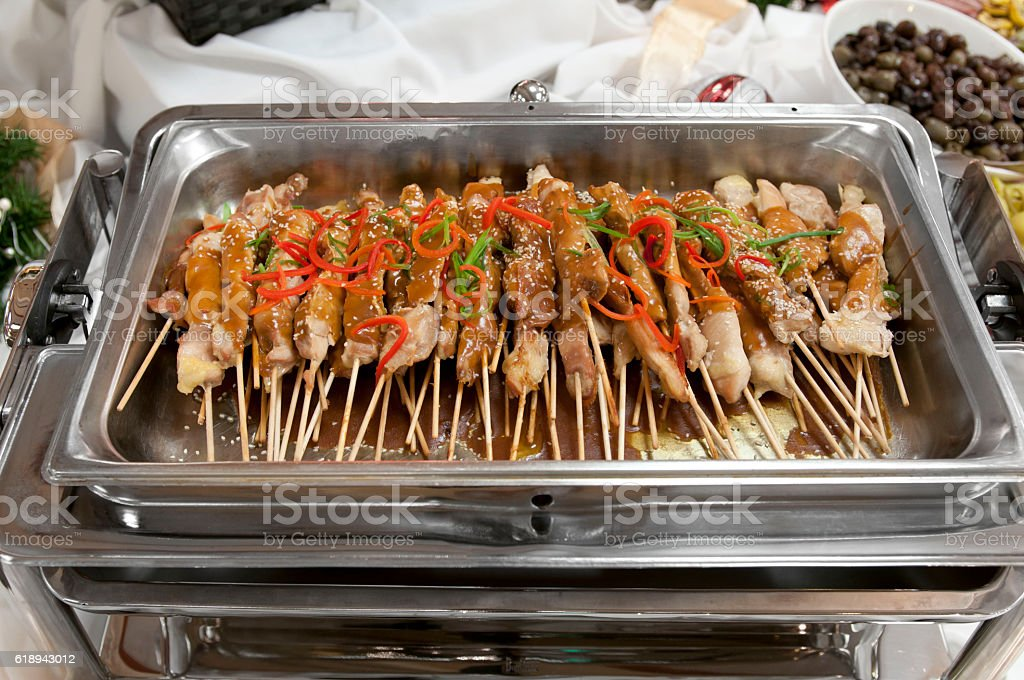 Skewered chicken w string peppers and sesame seeds stock photo