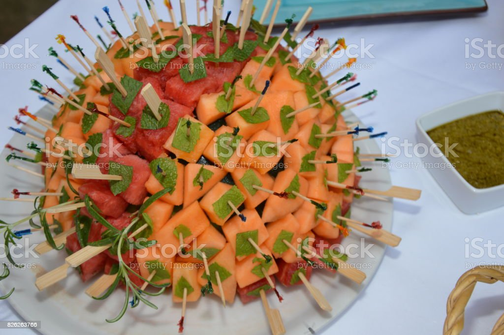 Skewered fruits,on a melon stock photo