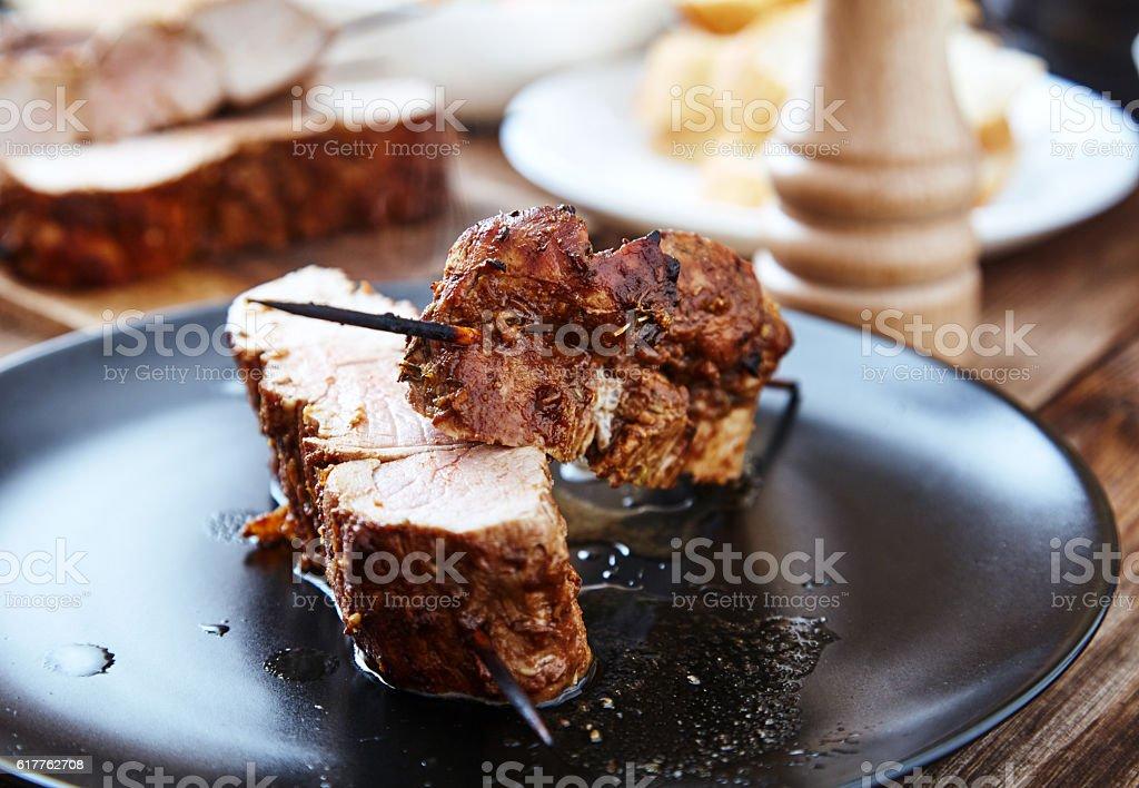 Skewered meat or shish kebabs of pork in marinade stock photo