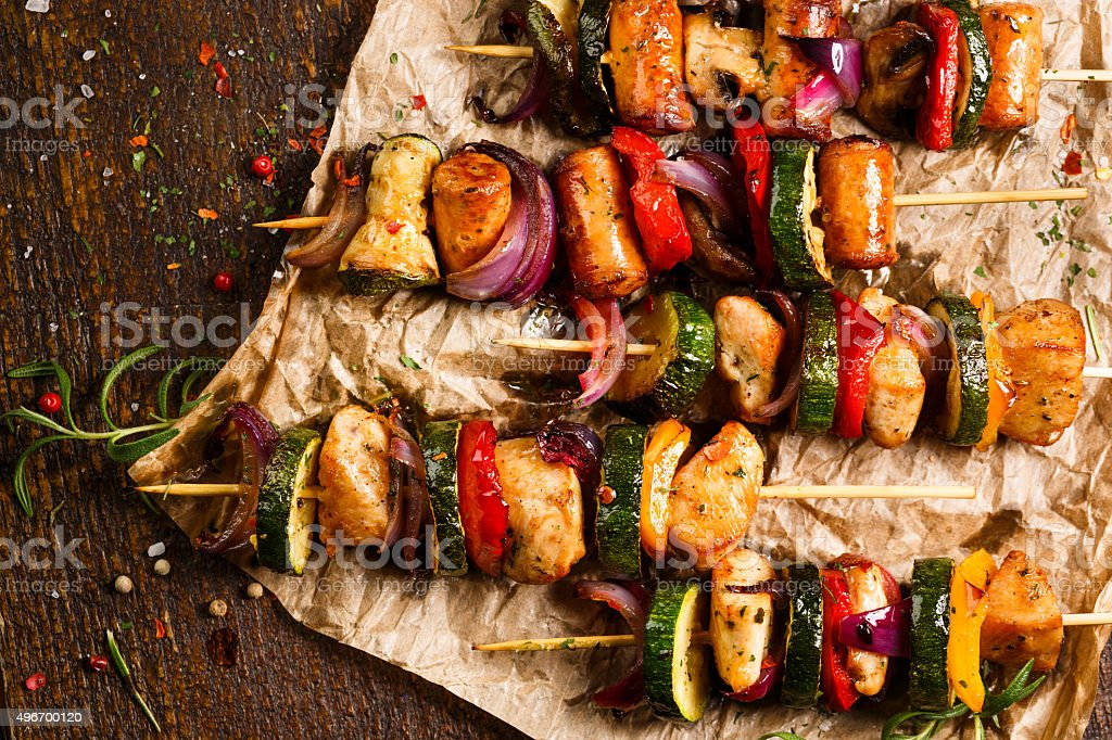 Skewers of grilled meat and vegetables stock photo