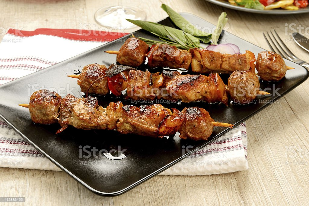 Skewers of meat cooked ready to eat stock photo