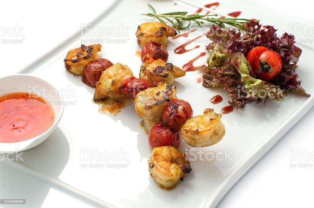 skewers of shrimp stock photo