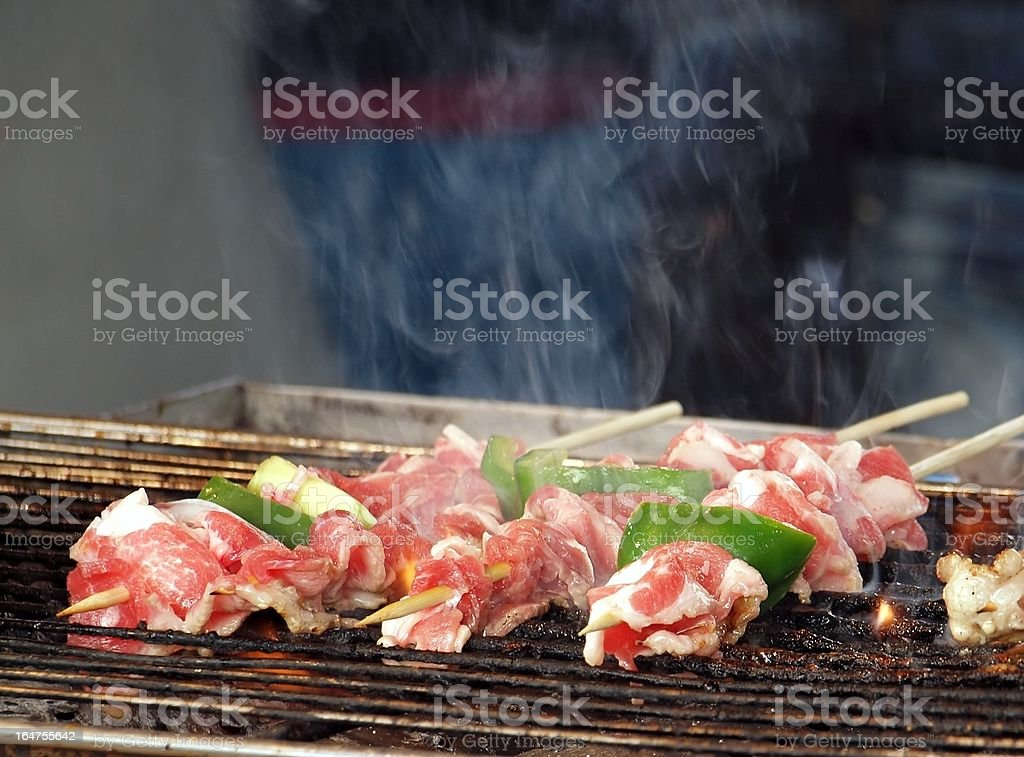 Skewers with Fresh Meat on a Grill royalty-free stock photo