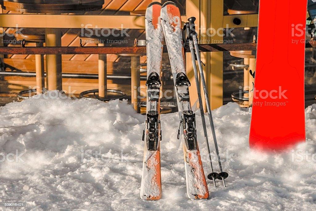 Ski accessories near of Coffee-house at a ski resort. stock photo