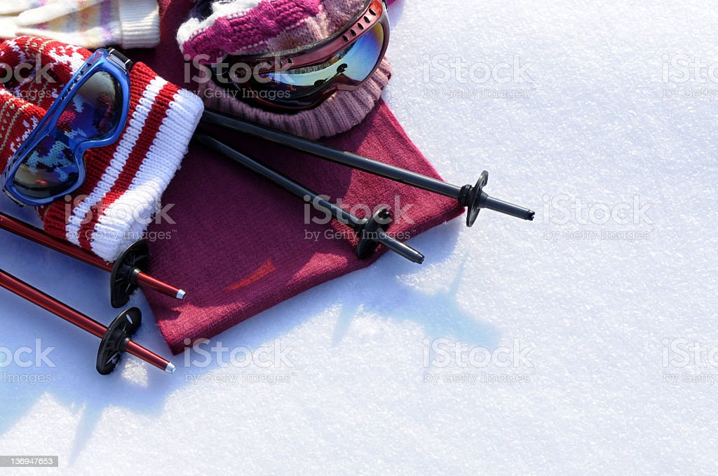 Ski accessories on a snow background stock photo