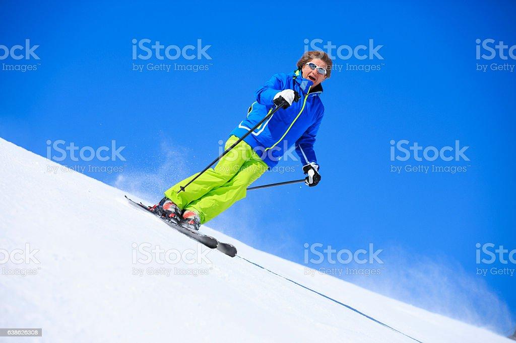 Ski Active senior men snow skier skiing Aging with attitude stock photo