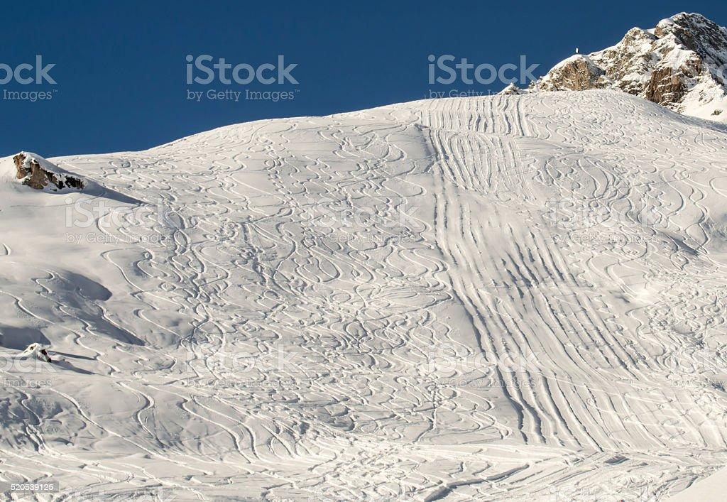 Ski and snowboard traces stock photo