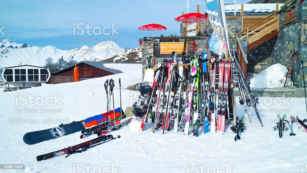 Ski and snowboards by a chalet in French Alps resort stock photo