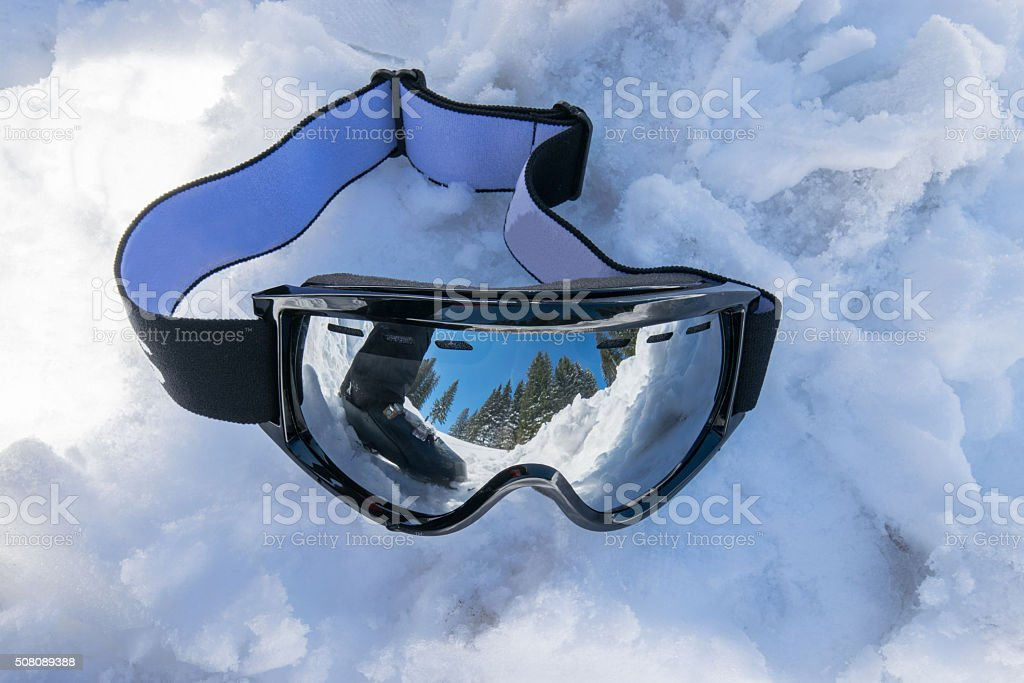 ski boot and landscape reflecting in ski glasses stock photo