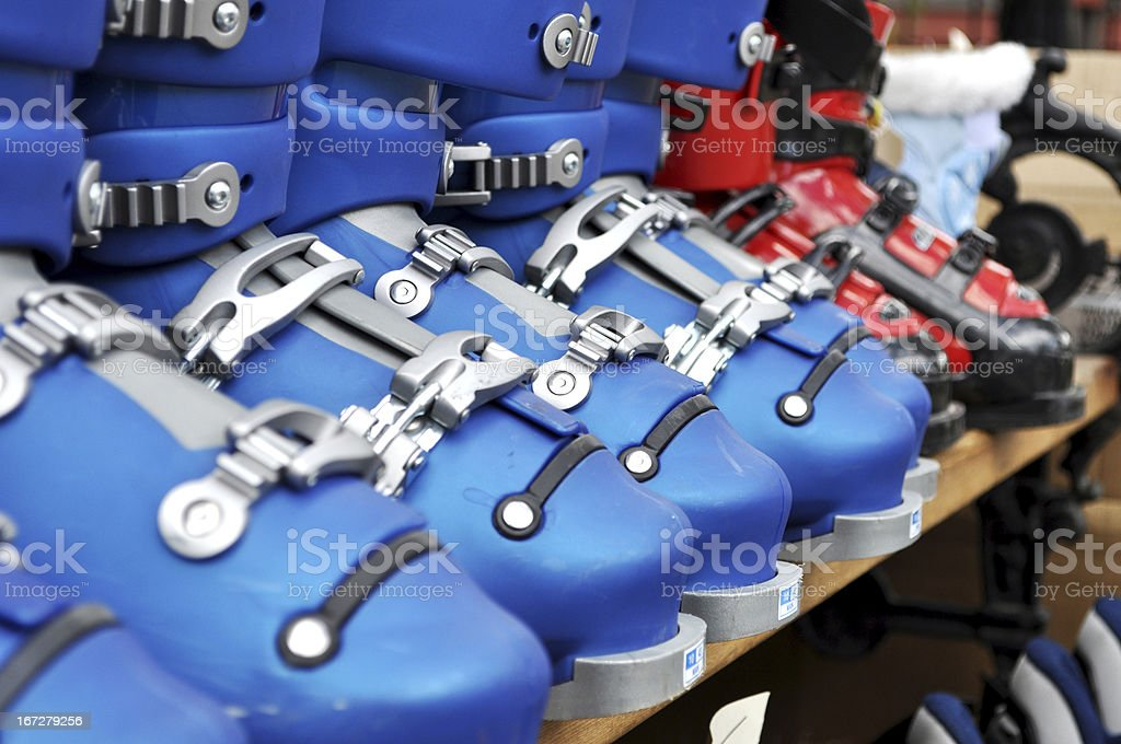 Ski boots in blue and red on the store shelf stock photo