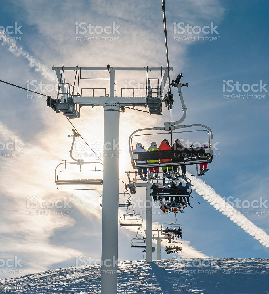 Ski chairlift going over a mountain stock photo