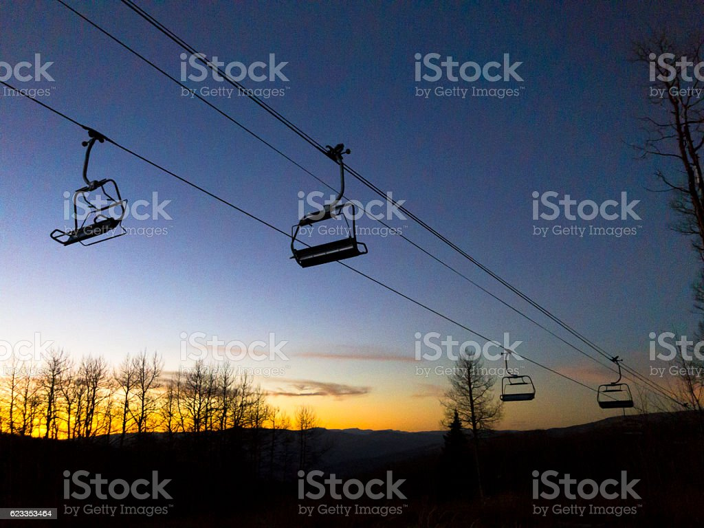 Ski Chairlift Silhouette At Sunset stock photo