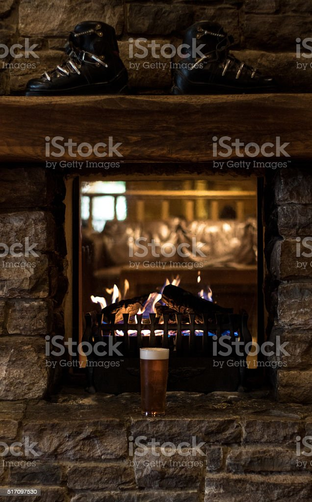 Ski Chalet Fire Place and Beer stock photo