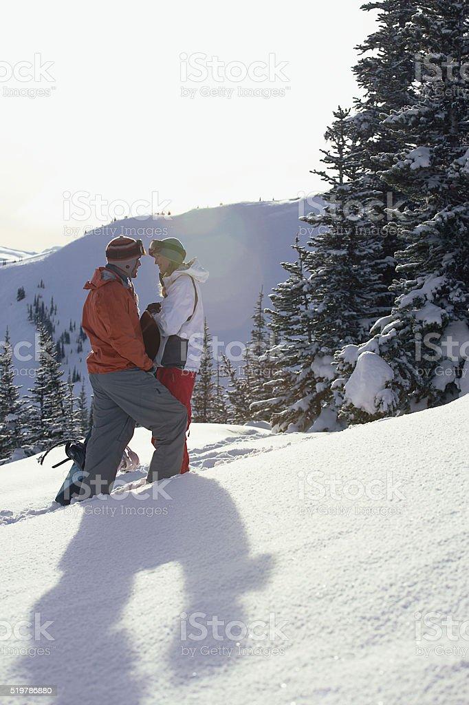 Ski couple in the mountain stock photo
