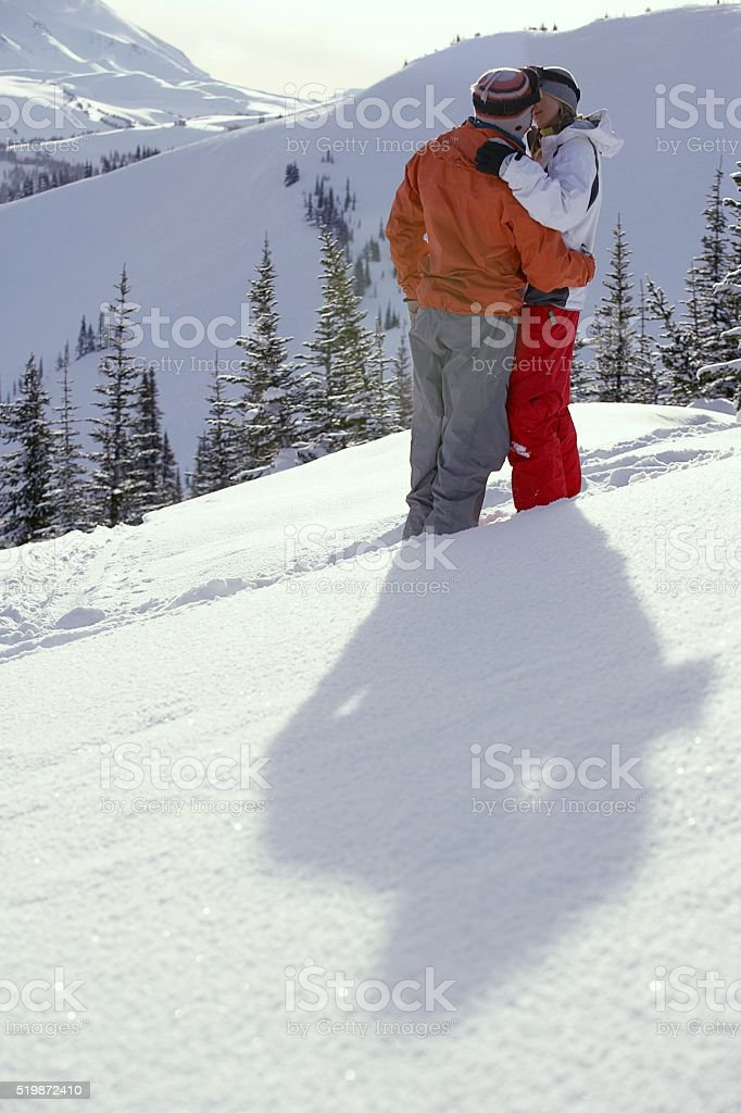 Ski couple kissing stock photo
