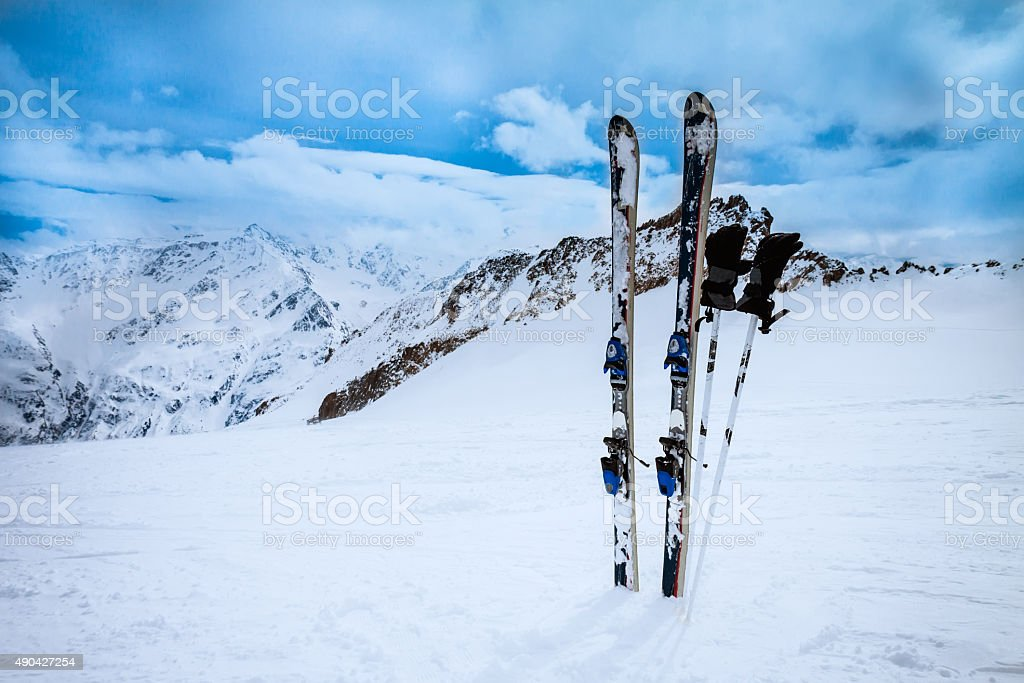 ski equipments on snow slope stock photo