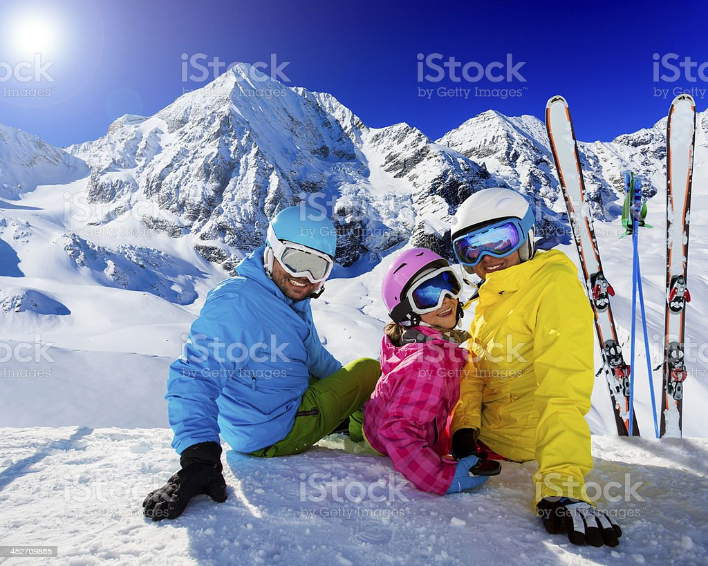 Ski Family enjoying winter vacations stock photo