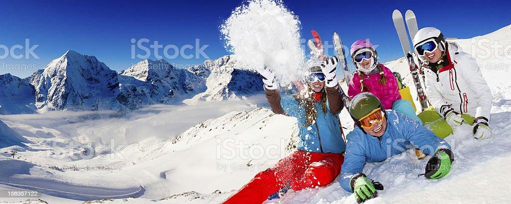 Ski family playing with snow stock photo