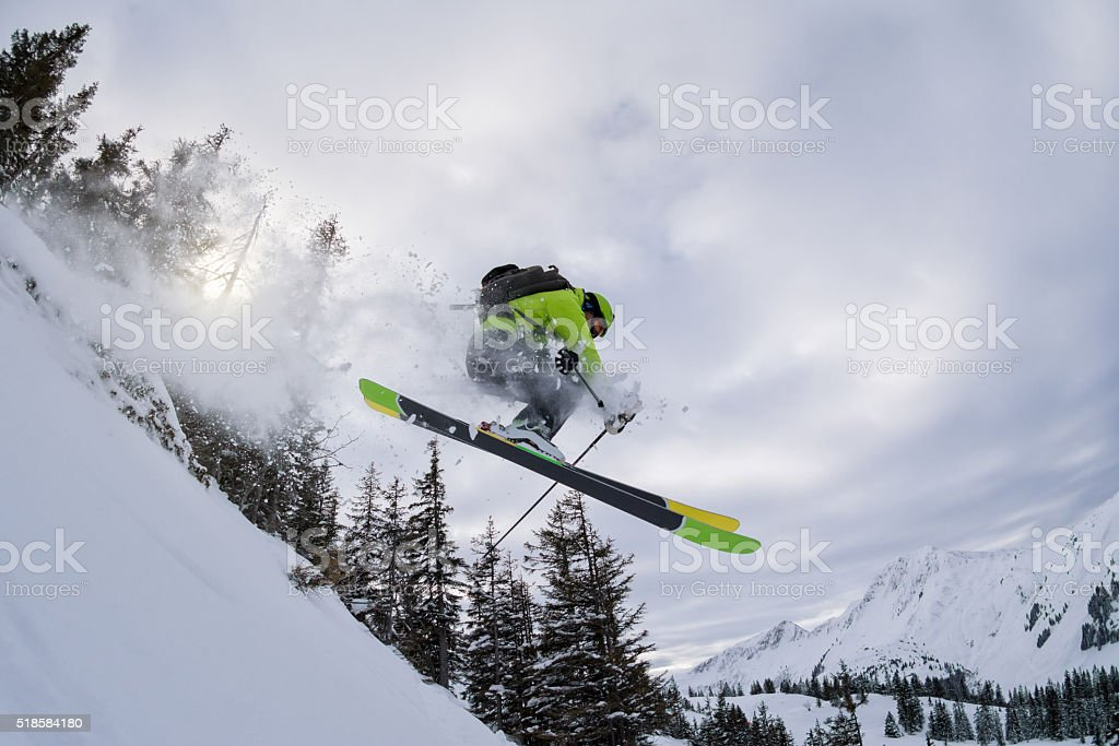 ski freerider jumping thourgh trees stock photo