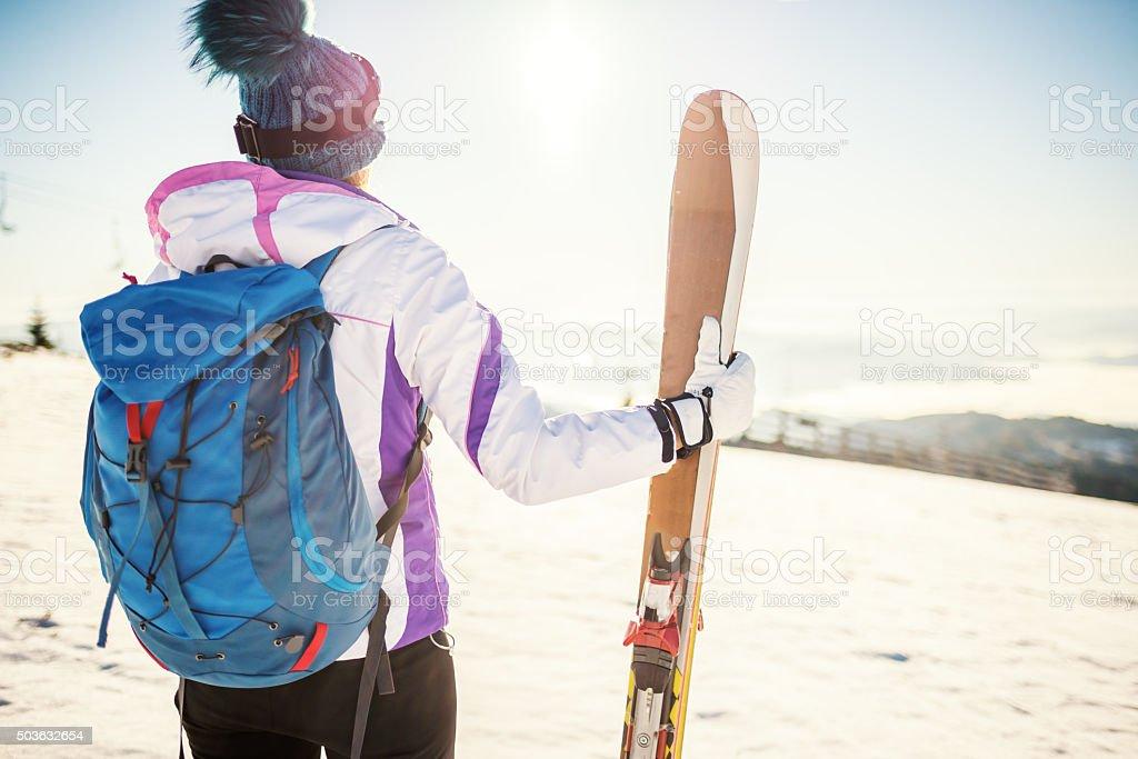 Ski girl on mountain stock photo