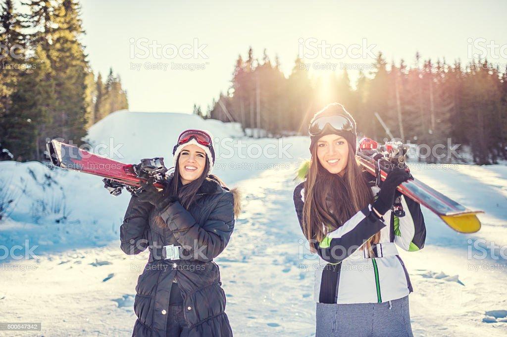 Ski girls on mountain stock photo