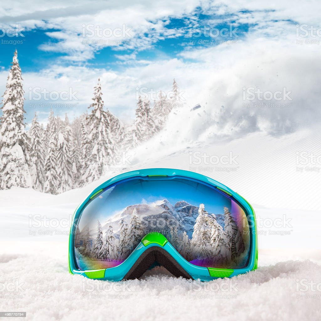 Ski glasses on snow. stock photo