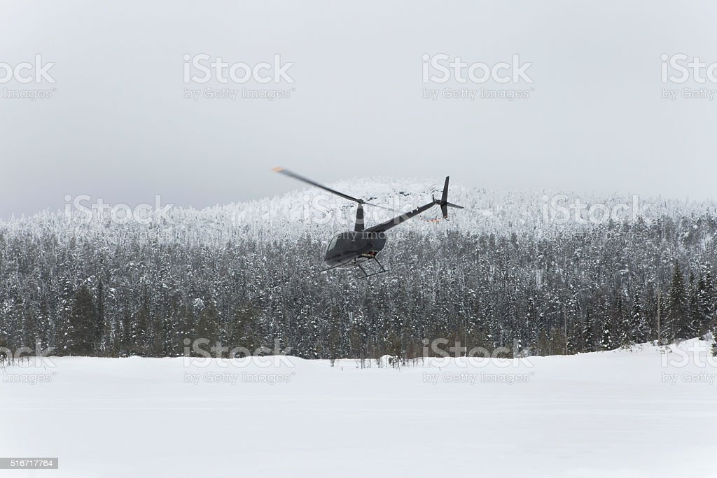 ski helicopter taking off stock photo