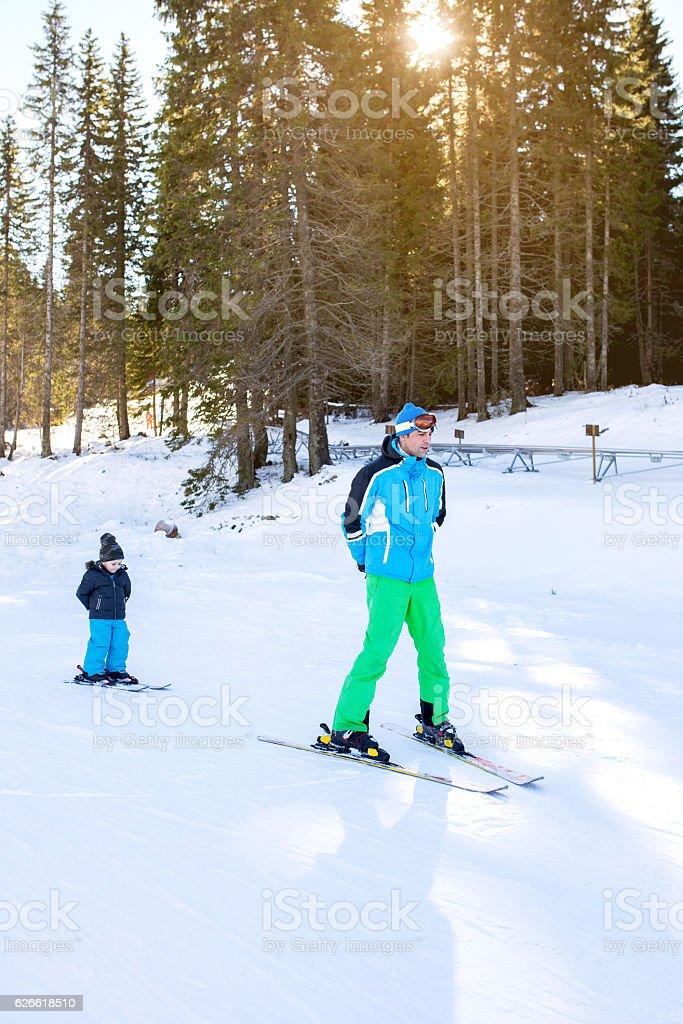 Ski instructor and little boy at ski slope. stock photo