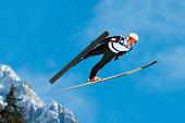 Ski jumper in mid-air
