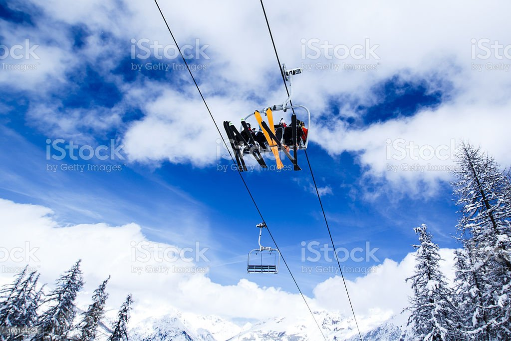 ski lift against blue sky stock photo