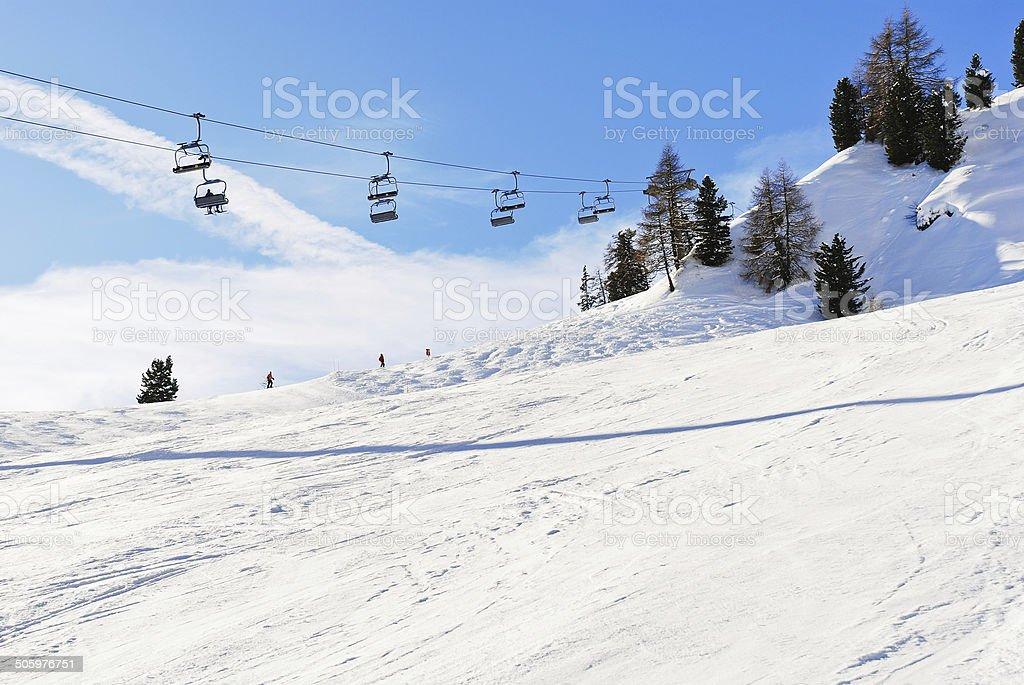 ski lift and slope of Dolomites mountains stock photo