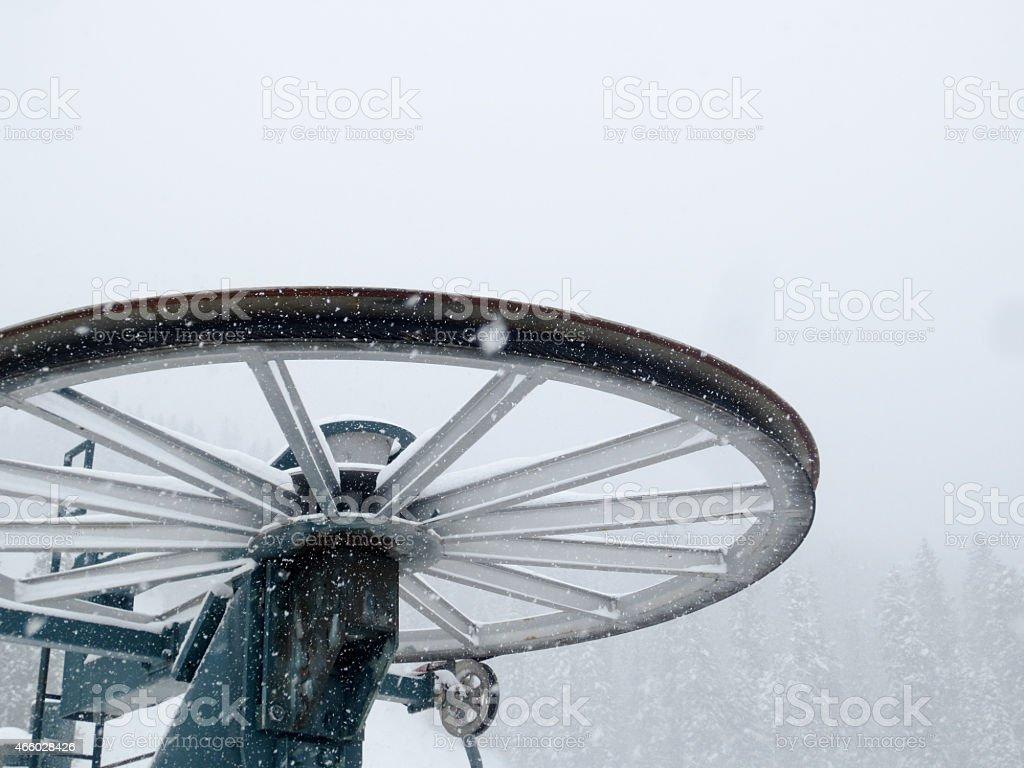 Ski Lift Bullwheel in a Snowstorm stock photo