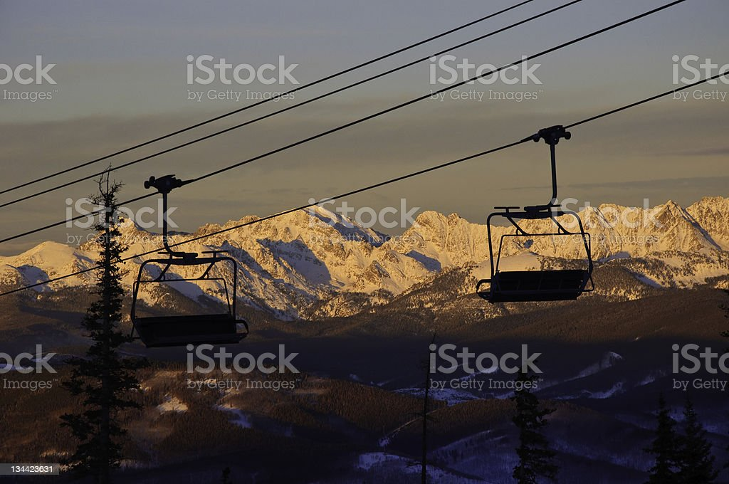Ski Lift Chairs at Sunset with Gore Range Colorado royalty-free stock photo
