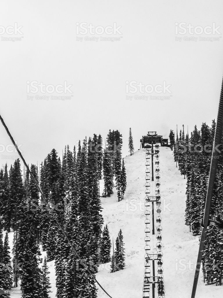 Ski lift in black and white with ski lift perspective stock photo