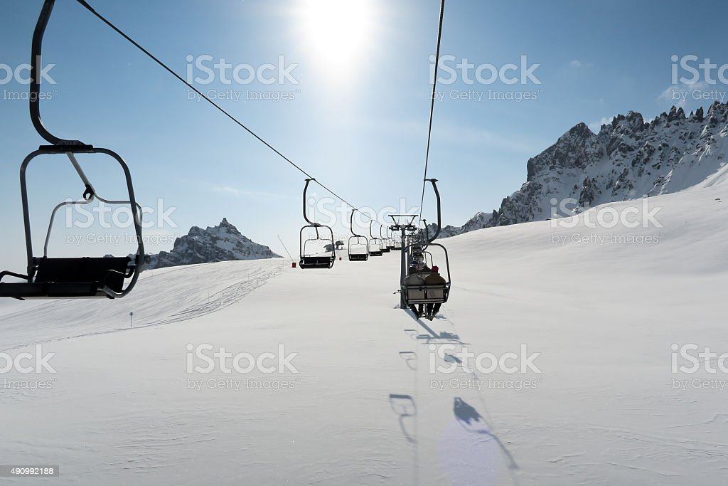 Ski lift in Italian Dolomites stock photo