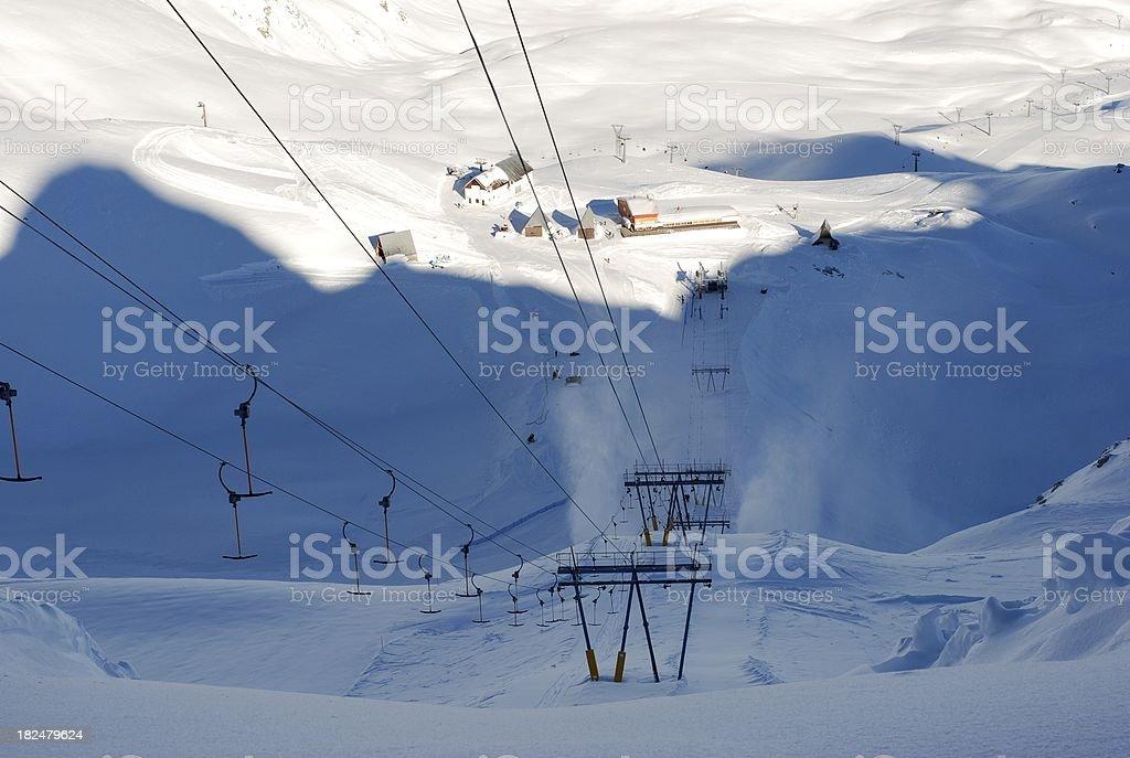 Ski lift in the shadow of mountain royalty-free stock photo
