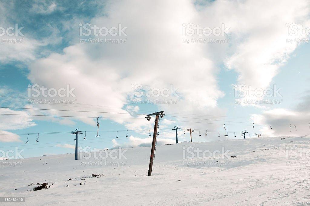 Ski lift up a mountain royalty-free stock photo