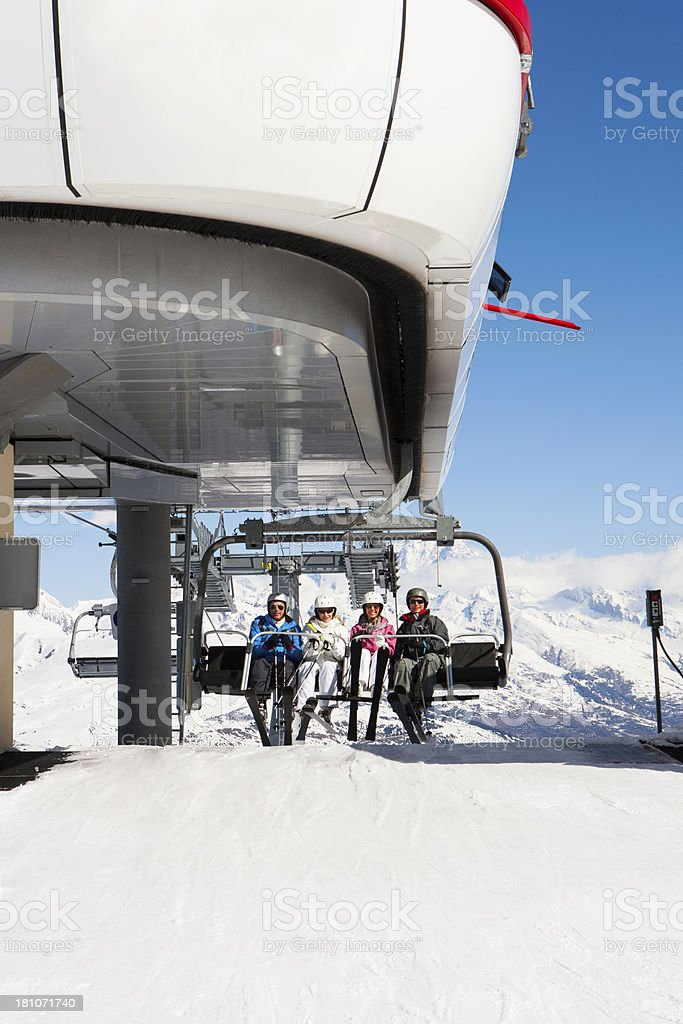 Ski Lift with Friends Reaching the Peak royalty-free stock photo