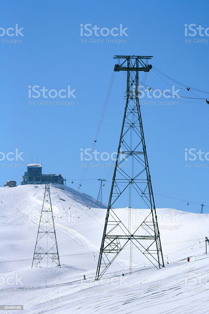Ski lift with sunny mountainside (vertical) stock photo
