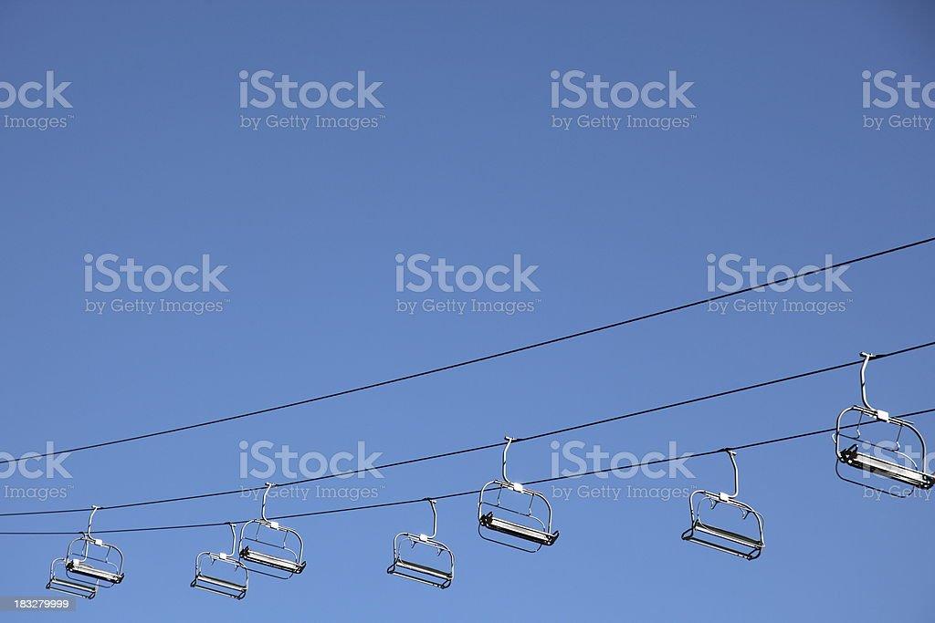 Ski lifts on blue sky background stock photo