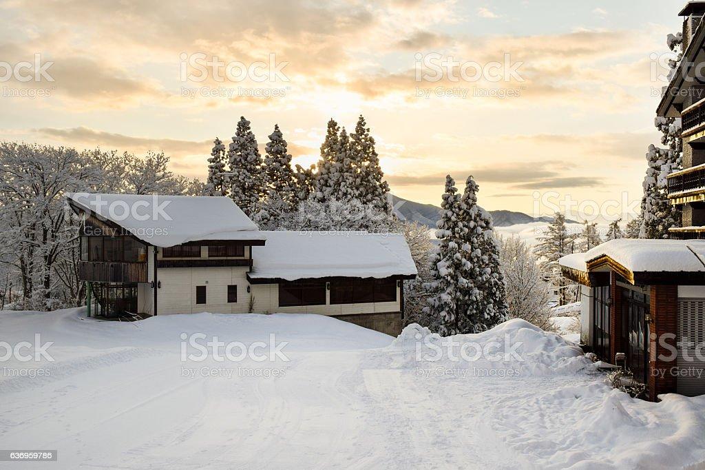 Ski lodges during early morning sunrise stock photo