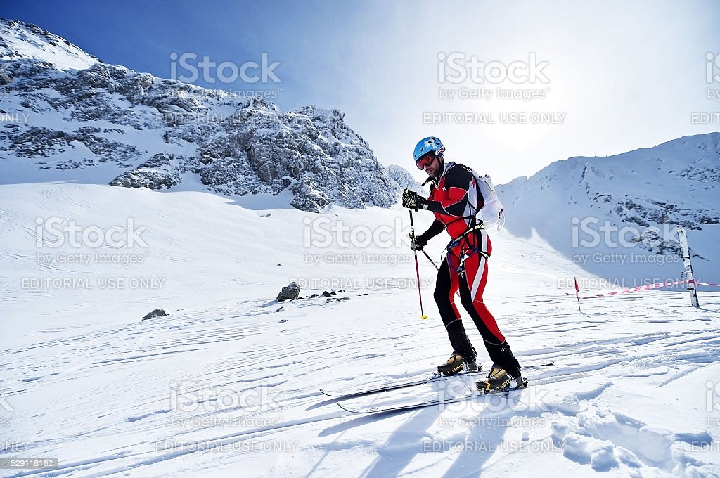 Ski mountaineer during competition in Fagaras Mountains stock photo