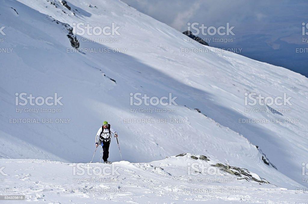 Ski mountaineer in Fagaras Mountains stock photo