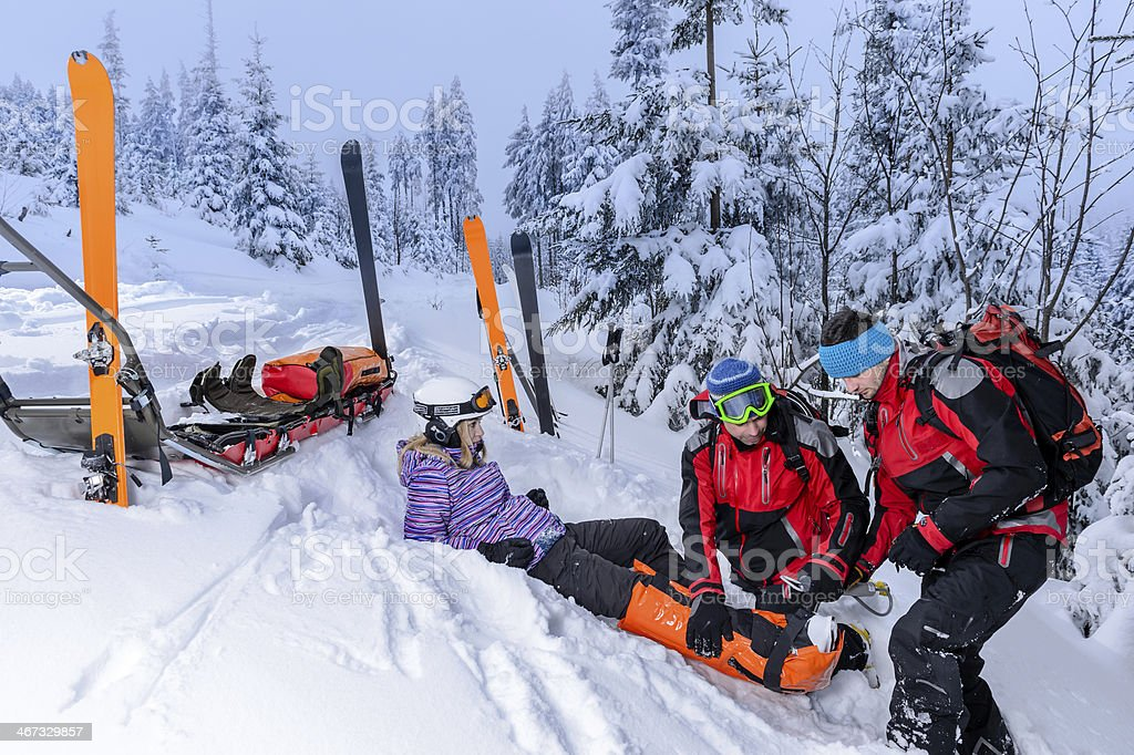Ski patrol team rescue woman broken leg stock photo