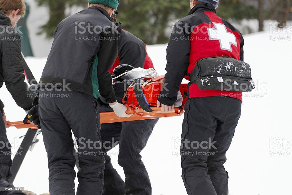 Ski Patrol Transporting Injured Skier stock photo