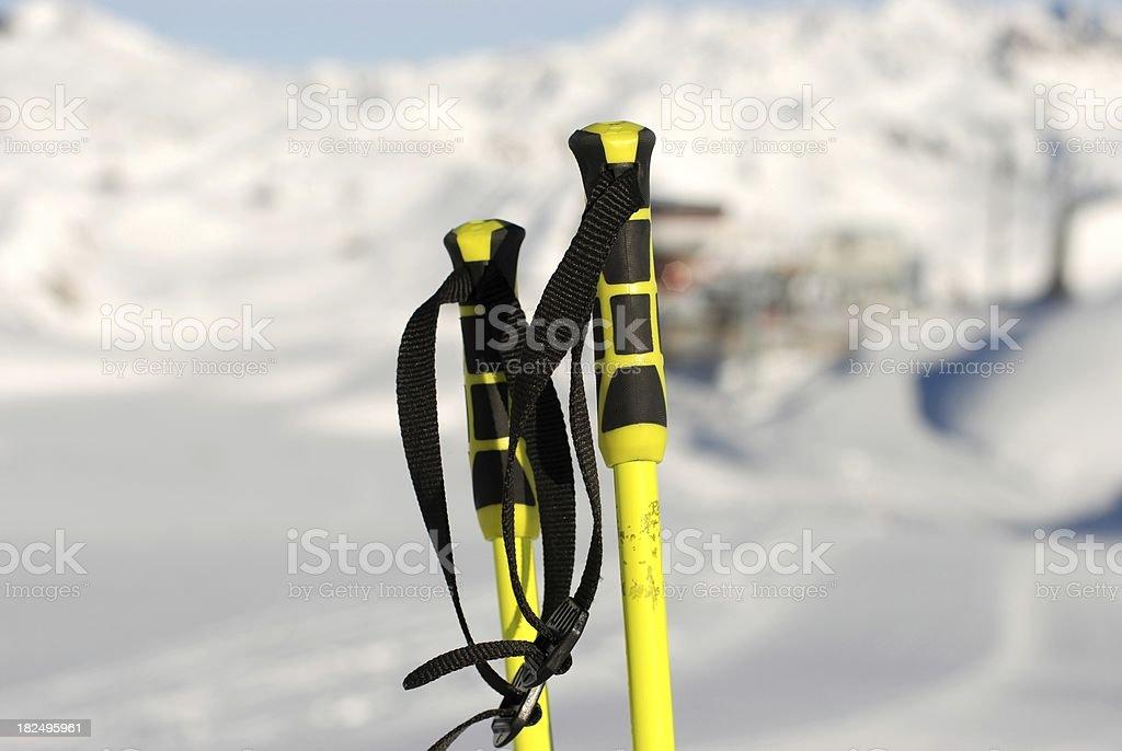 Ski poles and Dolomiti behind royalty-free stock photo