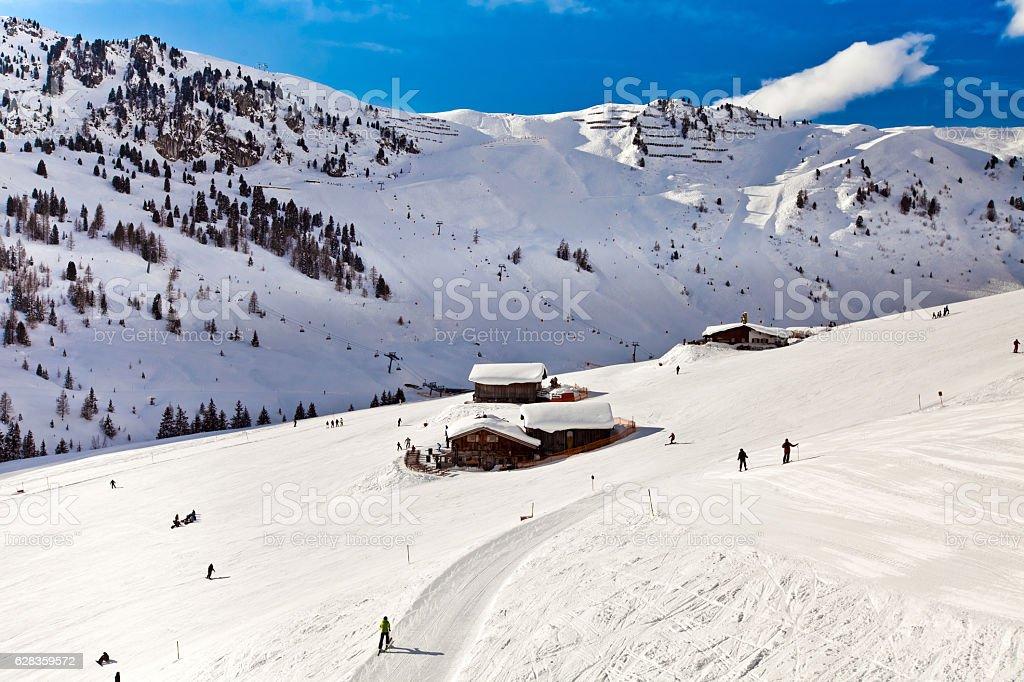 Ski resort in the Alps, people skiing stock photo