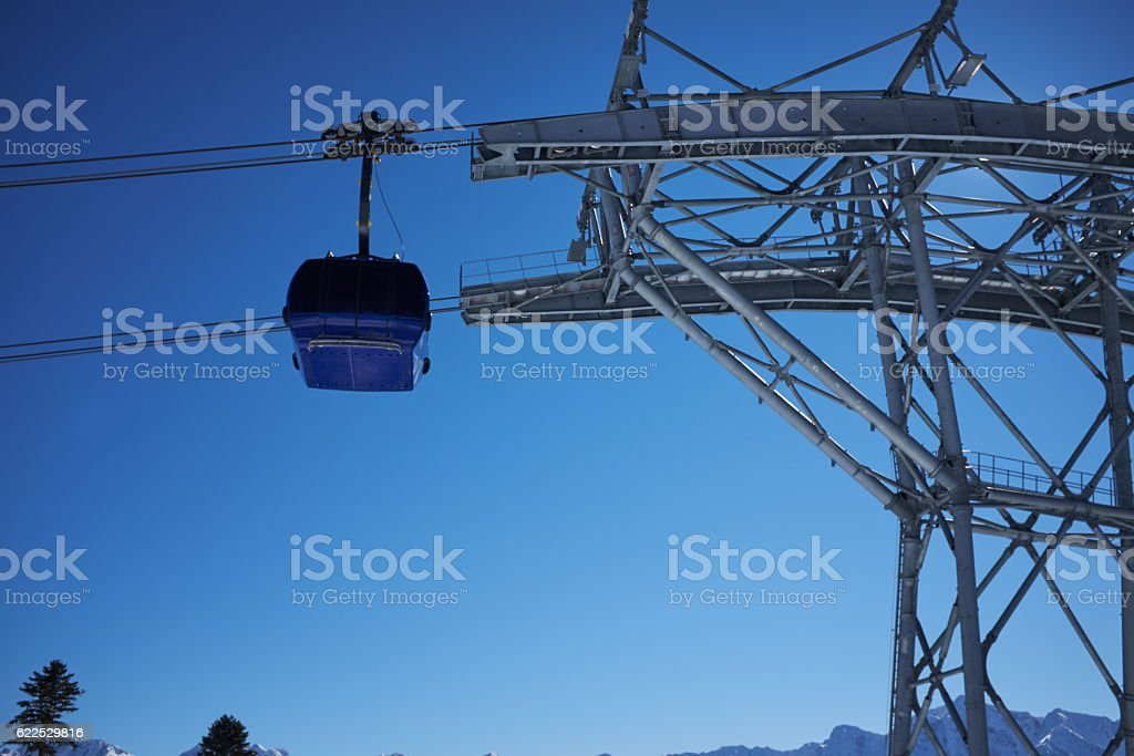 ski resort panorama with cable car lift cabin. Snow mountain stock photo