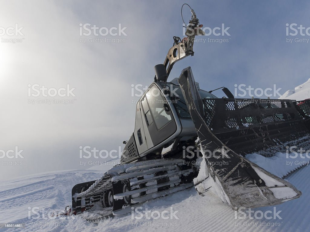 Ski resort snowcat parked on snow after preparing piste royalty-free stock photo