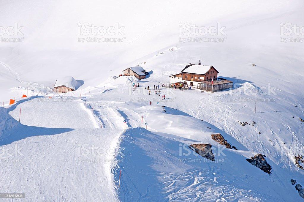 Ski run and hut in Alps stock photo